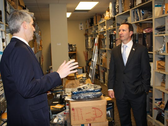 Corey Bourgeois, left, and Attorney General Jeff Landry