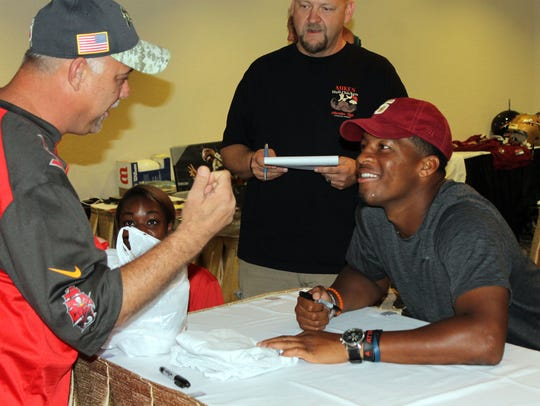 Heisman Trophy winner Jameis Winston signs autographs