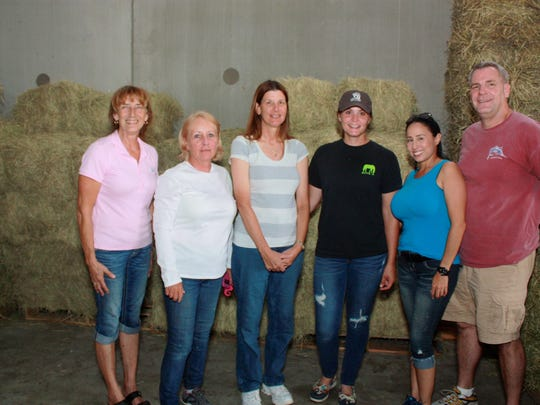 From left, Lori Hemings Kovac, owner of Palm City Horse and Hound Supply, Bobbi Martin, Equine Rescue and Adoption Foundation board member, Pam Hilles, Ashley Villerosi, ERAF barn coordinator, with Patty and Tom Deahn, heard Dr. Vander Werf's tips on emergency preparedness for horse owners.  Photo credit 2: Beverly Jones Photo caption 2: Brogan Sublett and Maria Martinez  Photo credit 3: Beverly Jones Photo caption 3: : Lori Hemings Kovac, owner of Palm City Horse and Hound Supply with Dr. Karie Vander Werf , Treasure Coast Equine Emergency Services and Madison Freeman.