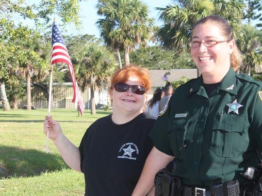 Patricia and Deputy Jessica Ogonoski walking in the 2017 Sebastian Fourth of July Parade.