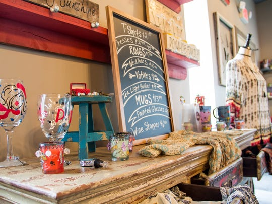 A variety of items for sale sit in the boutique section of Charmbiance Art Bar. MéShelle also designs these items herself.
