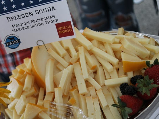 Blue ribbon cheeses were available for sampling during the Blue Ribbon Cheese and Butter auction at the Wisconsin State Fair.