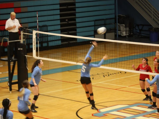 Ashley Conway goes up for a hit at the net during the game against Livingston Thursday night.
