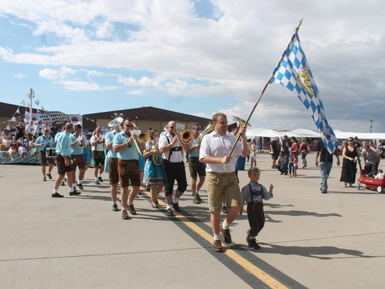 A member of the German air force carries the Bavarian flag into the GAF hangar to begin the 2017 Oktoberfest celebration.