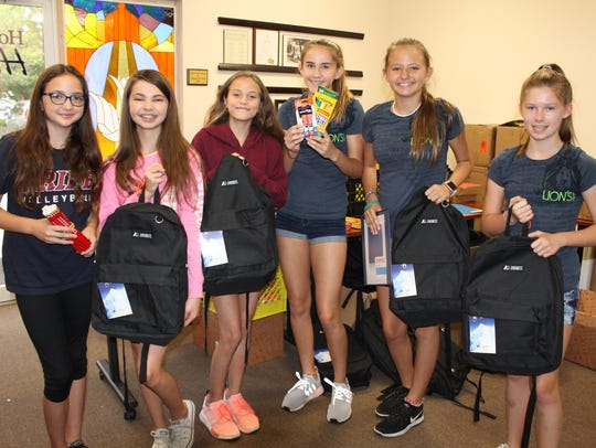 Youth volunteers from the Lionsheart Club prepare school