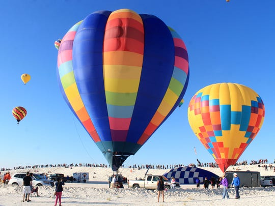 Hyggelig, owned by the Pattyn Family from Albuquerque, gets ready to take flight during the 25th annual White Sands Balloon Invitational