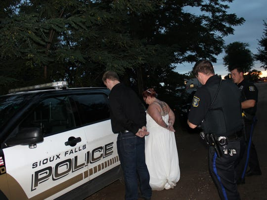 "Juaquina and Jesse Van Ommeren get ""arrested"" during some of their wedding photos."