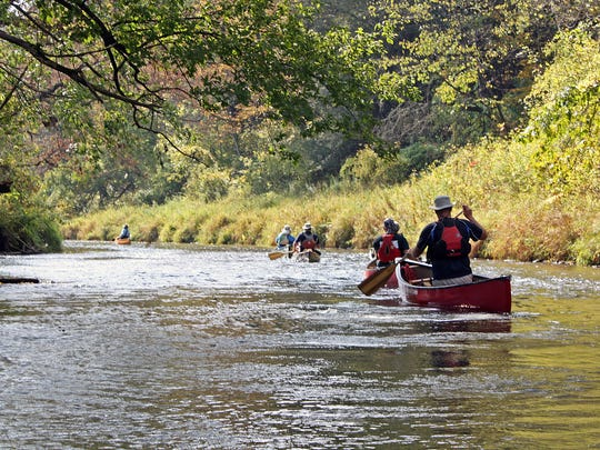 Canoers paddle down the winding Kickapoo River south of Ontario in Vernon County.