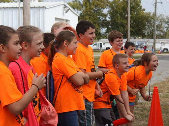 A group of students watches excitedly during a safety