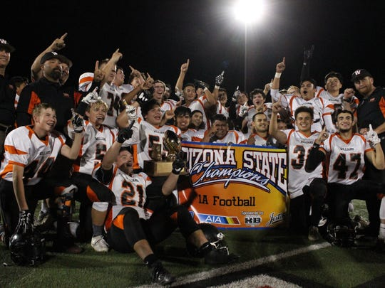 Williams poses with the 1A championship trophy on Friday,