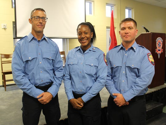 Richard Goodyear, Milicia Cook and Jeffrey Plaisted, from left, are the three most recent Murfreesboro Fire Rescue Department recruits to graduate from the Codes Academy, a requirement to become a full-time firefighter.