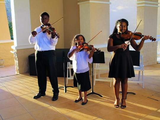"""Stars"" of the Gifford Youth Orchestra, from left, Luke Perry, Rebecca Dougall and Alexandria Powell perform at the Grand Harbor Beach Club on Oct. 27."