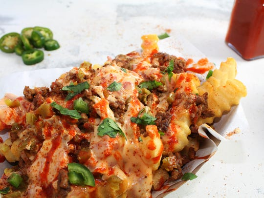 Taco Garage offers Garage Fries — crinkle fries topped