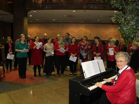 The Celebration Singers, led by director Betty Ann