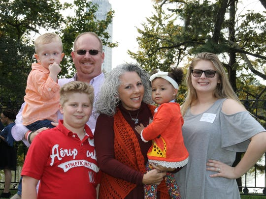 The Mock family at the 19th annual DCFS Adoption Reception at the Governor's Mansion on Nov. 16. Pictured from left are, Elijah (3), Kyle (11), Kevin, Tammy, Keona (2), and Kacey (14).