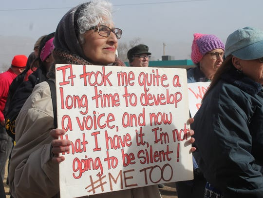 In this 2018 file photo, a woman holds up a sign at Alameda Park during the Women's March in Alamogordo at last year's march.