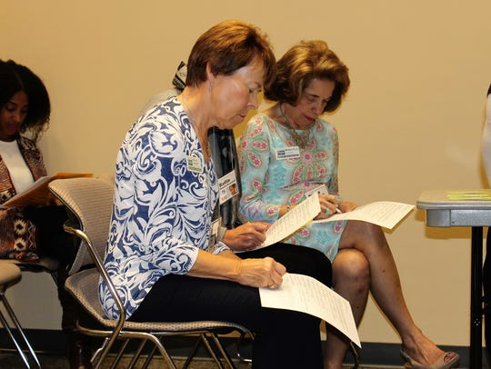 Deborah Lovequist and Michelle Trout take tests at