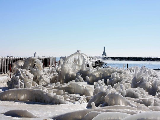 Whimsical ice formations build up on the shore near