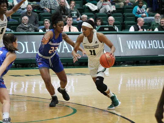 Binghamton University senior Imani Watkins looks to penetrate against UMass Lowell in Saturday's America East game at the Events Center. Watkins scored five points and became BU'S all-time leading scorer during a 52-38 victory.