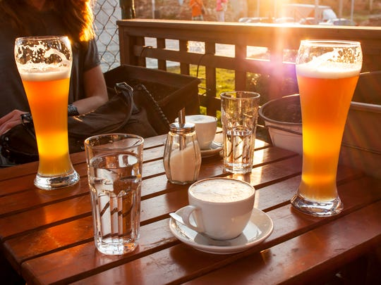 Beer and coffee on wooden table