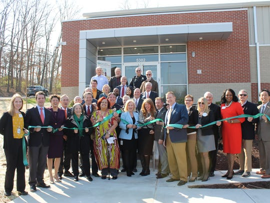 Representatives from Knox County, the City of Knoxville, the Tennessee Department of Mental Health, Helen Ross McNabb Center and community partners participate in the ribbon-cutting for the Behavioral Health Urgent Care Center last year.