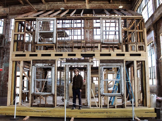 Artist Ryan Mendoza stands in the doorway of the partially assembled house, where Rosa Parks once lived in Detroit, in the WaterFire Arts Center in Providence, R.I. on March 11, 2018.