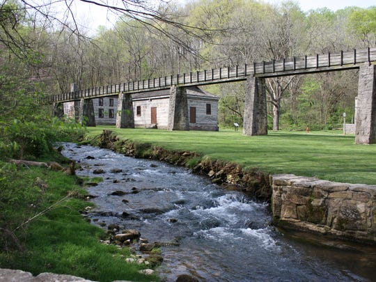 Mill Creek with water flume in background in Pioneer Village of Spring Mill State Park.