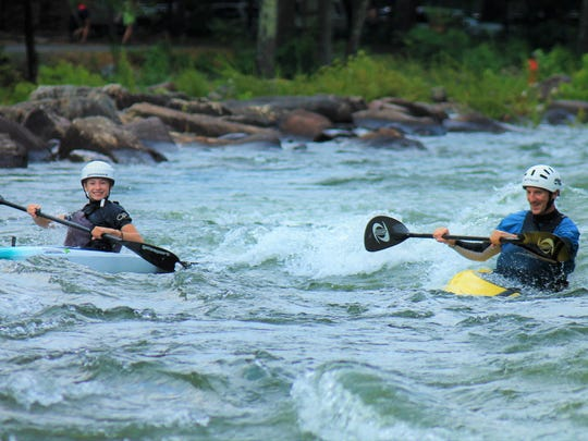 Evy Leibfarth of Bryson City trains on the Ocoee River with her father and coach, Lee Leibfarth, a former U.S. National Slalom Team member.