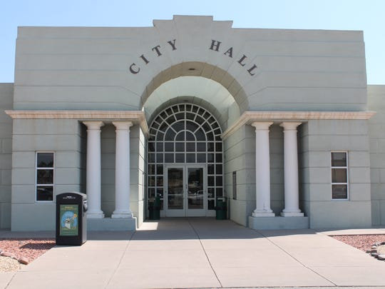 In this file photo, the exterior of City Hall has faded into a greenish color.
