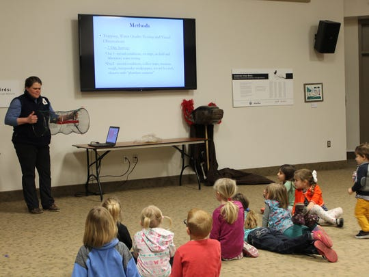 Rebecca Johnson, the Associate Curator of Amphibians for the Detroit Zoological Society, giving a presentation about mudpuppies to her audience at the Mudpuppypalooza at the Belle Isle Nature Center on  Sunday, April 8, 2018.