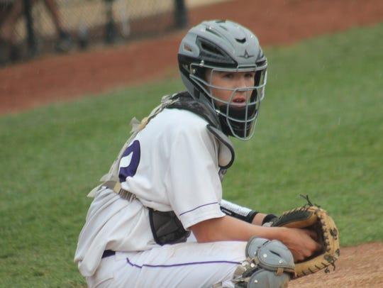 Sophomore catcher Kory Klingenbeck eyes the signal