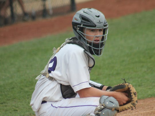 Sophomore catcher Kory Klingenbeck eyes the signal to give his brother Kyle on the mound for Elder vs. West Clermont