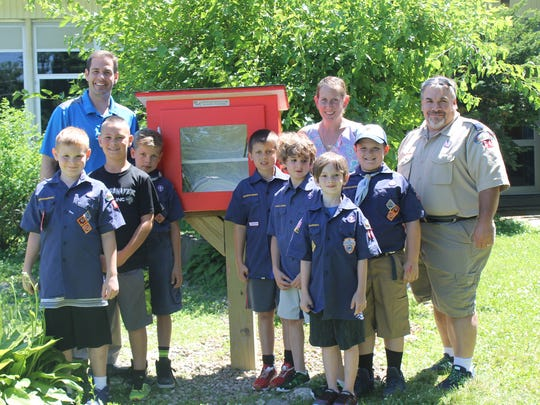 Cub Scout Pack 64 poses with their creation, accompanied by Adamsville principal Dr. James Singagliese, Adamsville librarian Kelly Mumber and Den Leader Carmine De San