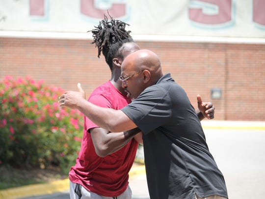 2019 three-star FSU defensive back commit Travis Jay meets with defensive coordinator and defensive backs coach Harlon Barnett on a visit to FSU in June 2018.