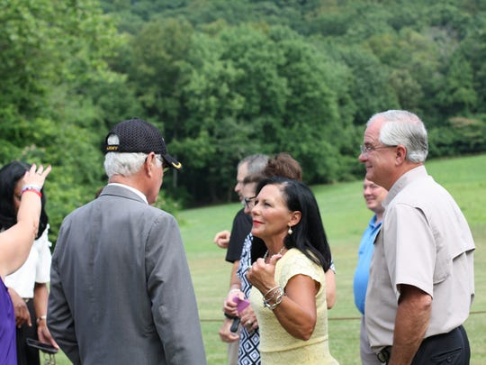 Commissioner Michele Carringer speaks with members of Emma Walker's family after the renaming ceremony on June 20.
