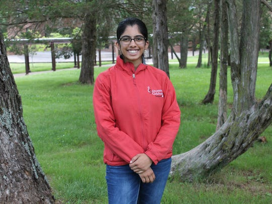 Veda Kota poses for a picture on the campus of Somerset County Vocational & Technical High School.
