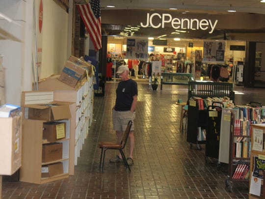 A customer looks at materials available on the shelves outside the Books Revisited book shop in White Sands Mall Wednesday.
