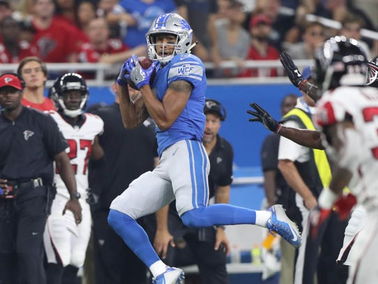 TJ Jones makes a catch against the Falcons in the third