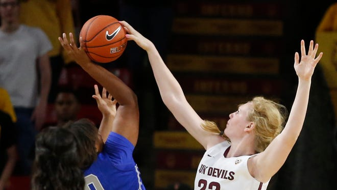 ASU's Quinn Dornstauder blocks a shot by Middle Tennessee's Caya Williams during the second half of a women's college basketball game at Wells Fargo Arena in Tempe on Nov. 14, 2014.