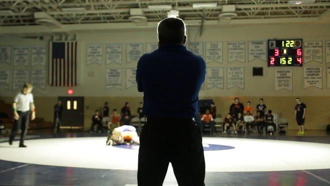 Stephen Decatur wrestling coach Todd Martinek watches a match during a meet.