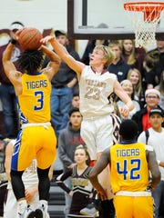 Webster County's Chatman Ellis (23) blocks a shot from Caldwell County's Josh Wilkerson (3) during their game at Webster County High School in Dixon, Thursday, Dec. 15, 2016.