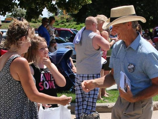 Organic farmer Russ Brown, who is challenging Rep. Scott Krug, R-Nekoosa, campaigns in Wisconsin Rapids during the Cranberry Blossom Festival Parade on June 19, 2016. Brown, a Democrat, and Krug agree water quality and quantity are key issues in the race for the 72nd Assembly District seat.