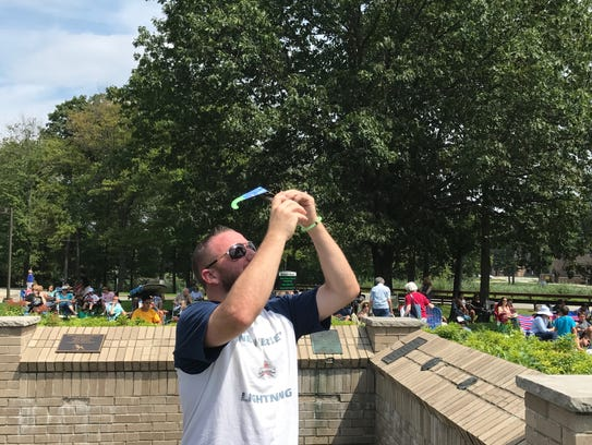 Sean Brock of Woodland Park trying to capture eclipse