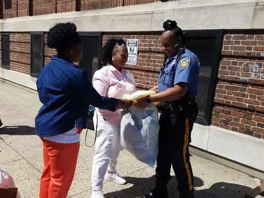 Plainfield Police Officer Teisha Franklin drops off