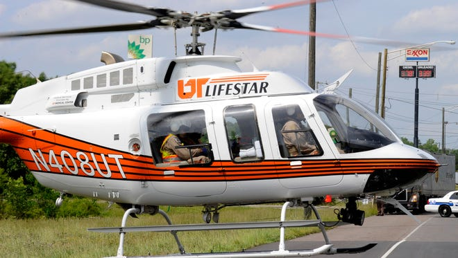 A University of Tennessee Medical Center Lifestar helicopter is pictured May 20, 2014. Phyllis Walker, program director for Lifestar, says more than 25 flights have been missed over the past three days because of the smoke that has covered East Tennessee.