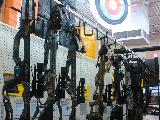 A row of crossbows rest in a sporting good store in this file photo.