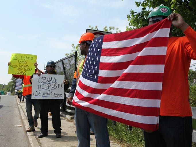 Minority construction workers protest along Route 9 in Tarrytown as President Obama is expected to talk about the Tappan Zee Bridge construction. They say that they are shut out from many area construction projects.