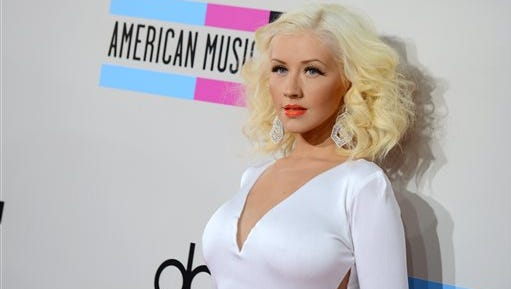 """In this file photo, Christina Aguilera arrives at the American Music Awards at the Nokia Theatre L.A. Live, in Los Angeles. The NBA announced Tuesday that Aguilera will perform ahead of the 64th annual NBA All-Star Game on Feb. 15 at Madison Square Garden in New York City. She will sing a """"New York-themed medley"""" during player introductions and be joined by The Rockettes dance troupe."""