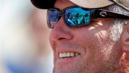 Former Green Bay Packers quarterback Brett Favre looks out onto the field before playing a flag football game Sunday, July 19, 2015, at Camp Randall Stadium in Madison, Wis. Favre was inducted into the Packers Hall Fame Saturday. (AP Photo/Andy Manis)