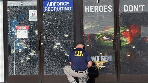 In this July 17, 2015 file photo, an FBI investigator investigates the scene of a shooting outside a military recruiting center in Chattanooga.